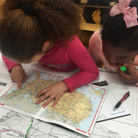 youth exploring map